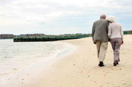 OLD COUPLE WALKING ON BEACH